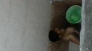 Indian girl taking a bath in hotel room