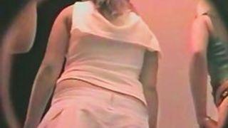 Bare bottom upskirt brunette in a baby blue skirt captured on film
