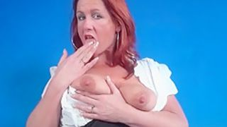 Skirt and blouse on mature redhead in erotic porn