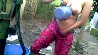 Bangla desi shameless village cousin-Nupur bathing outdoors